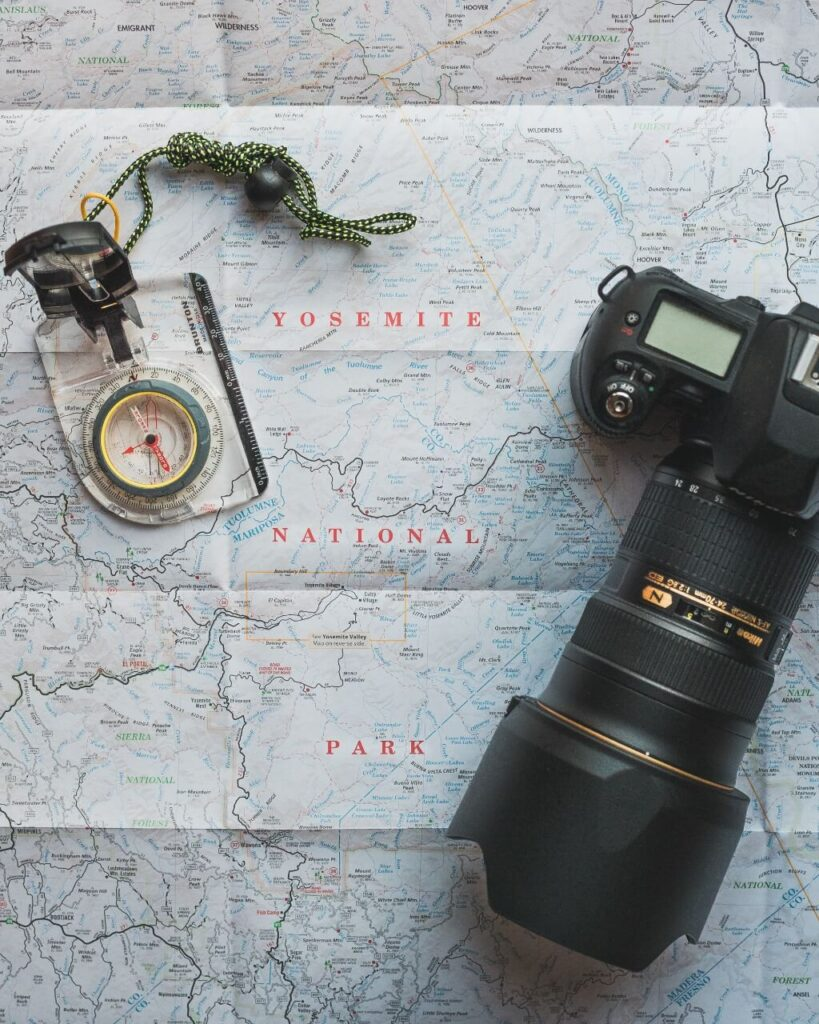 Photo of a camera, map, & direction map